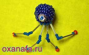 глаз и четыре ноги паука из бисера